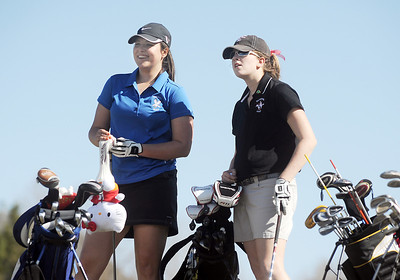 Alex Briggs, left, Broomfield, chats with Megan McCambridge, Fairview, while waiting to tee off of the 11th hole at the Chilly/Chili Invite golf tournament hosted by Broomfield High School at the Eagle Trace golf Course on Saturday. March 17,  2012  staff photo/ David R. Jennings