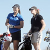 Alex Briggs, left, Broomfield, chats with Megan McCambridge, Fairview, while waiting to tee off of the 11th hole at the Chilly/Chili Invite golf tournament hosted by Broomfield High School at the Eagle Trace golf Course on Saturday.<br /> March 17,  2012 <br /> staff photo/ David R. Jennings