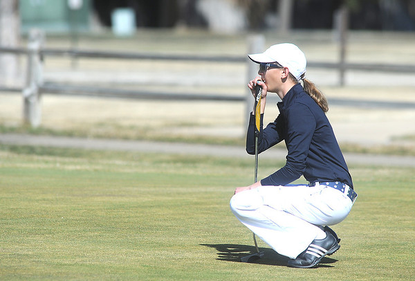 Legacy's Sara Hankins checks the lay of the green on the 6th hole at the Chilly/Chili Invite golf tournament hosted by Broomfield High School at the Eagle Trace golf Course on Saturday.<br /> March 17,  2012 <br /> staff photo/ David R. Jennings