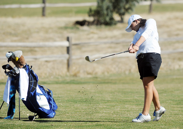 Broomfield's Taylor Dorans chips the ball on the 11th green at the Chilly/Chili Invite golf tournament hosted by Broomfield High School at the Eagle Trace golf Course on Saturday.<br /> March 17,  2012 <br /> staff photo/ David R. Jennings