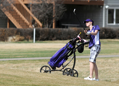 Boulder's Danille Picard chips the ball to the 1st green at the Chilly/Chili Invite golf tournament hosted by Broomfield High School at the Eagle Trace golf Course on Saturday. March 17,  2012  staff photo/ David R. Jennings