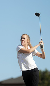 Skyline's Haiden DeJane watches the ball after teeing off of the 11th hole at the Chilly/Chili Invite golf tournament hosted by Broomfield High School at the Eagle Trace golf Course on Saturday. March 17,  2012  staff photo/ David R. Jennings
