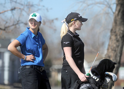 Taylor Dorans, left, Broomfield, and Kelly Moran, Fairview, wait to tee off of the 12th hole at the Chilly/Chili Invite golf tournament hosted by Broomfield High School at the Eagle Trace golf Course on Saturday. March 17,  2012  staff photo/ David R. Jennings
