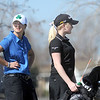 Taylor Dorans, left, Broomfield, and Kelly Moran, Fairview, wait to tee off of the 12th hole at the Chilly/Chili Invite golf tournament hosted by Broomfield High School at the Eagle Trace golf Course on Saturday.<br /> March 17,  2012 <br /> staff photo/ David R. Jennings