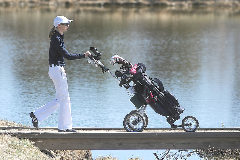 Sara Hankins, Legacy, walks across a bridge to the 7th tee at the Chilly/Chili Invite golf tournament hosted by Broomfield High School at the Eagle Trace golf Course on Saturday.<br /> March 17,  2012 <br /> staff photo/ David R. Jennings