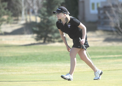 Fairview's Kelly Moran walks to place her ball on the 11th green at the Chilly/Chili Invite golf tournament hosted by Broomfield High School at the Eagle Trace golf Course on Saturday. March 17,  2012  staff photo/ David R. Jennings