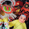The Happy Budha, Alan Tran, guides the lions through the restaurant for  traditional Chinese Lion Dance performed by members of the Tai Kung Ha Holistic Fitness Center for Chinese NewYear at United Chinese Restaurant on Sunday. February 3rd is the beginning of the Chinese New Year, the year of the rabbit.<br /> <br /> January 30, 2011<br /> staff photo/David R. Jennings