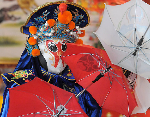 Magician Peng Li, from New York,  a master of the Chinese art of face mask changing, BianLian, dances with umbrellas before revealing another face during the Chinese NewYear celebration at United Chinese Restaurant on Sunday. February 3rd is the beginning of the Chinese New Year, the year of the rabbit.<br /> <br /> January 30, 2011<br /> staff photo/David R. Jennings