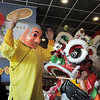 The Happy Budha, Alan Tran, guides the baby Lion , Samir Krimov, 8, with the traditional Lions dance in celebration of the Chinese New Year  performed by members of the Tai Kung Ha Holistic Fitness Center at United Chinese Restaurant on Sunday. February 3rd is the beginning of the Chinese New Year, the year of the rabbit.<br /> <br /> January 30, 2011<br /> staff photo/David R. Jennings