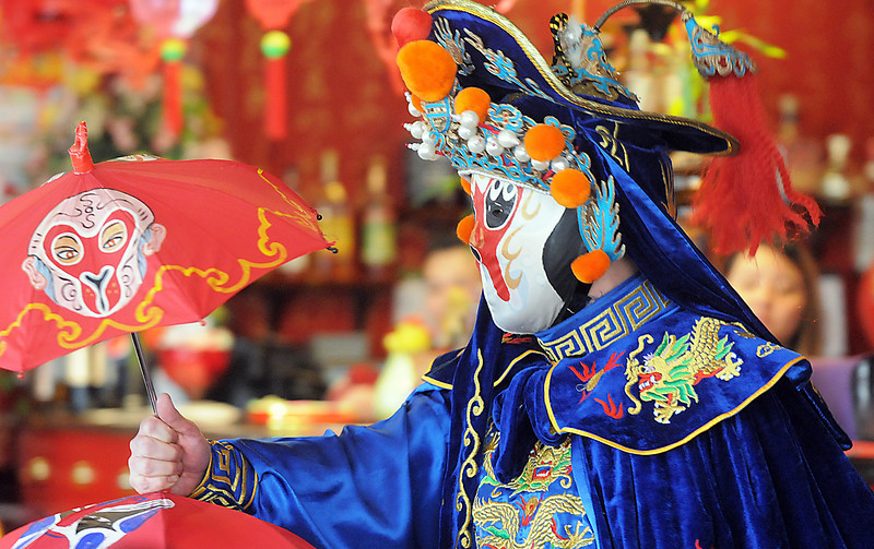 Magician Peng Li, a master of the Chinese art of face mask changing,  reveals another mask in less than a second while performing the rare ancient Chinese dramatic art of Bian Lian a part of the Sichuan opera for the Chinese New Year celebration at United Chinese Restaurant on Sunday.February 3rd is the beginning of the Chinese New Year, the year of the rabbit.<br /> <br /> January 30, 2011<br /> staff photo/David R. Jennings