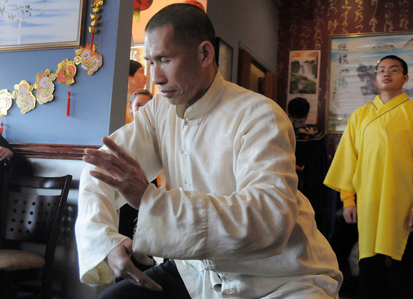 Daniel Lee Ha of the Tai Kung Ha Holistic Fitness Center performs at United Chinese Restaurant on Sunday. February 3rd is the beginning of the Chinese New Year, the year of the rabbit.<br /> <br /> January 30, 2011<br /> staff photo/David R. Jennings