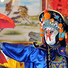 Magician Peng Li, a master of the Chinese art of face mask changing, moves to reveal another mask while performing the rare ancient Chinese dramatic art of Bian Lian a part of the Sichuan opera for the Chinese New Year celebration at the Broomfield United Chinese Restaurant on Sunday.<br /> <br /> January 30, 2011<br /> staff photo/David R. Jennings