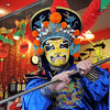 Magician Peng Li, a master of the Chinese art of face mask changing, moves to reveal another mask while performing the rare ancient Chinese dramatic art of Bian Lian a part of the Sichuan opera for the Chinese New Year celebration at the Broomfield United Chinese Restaurant on Sunday. February 3rd is the beginning of the Chinese New Year, the year of the rabbit.<br /> <br /> January 30, 2011<br /> staff photo/David R. Jennings