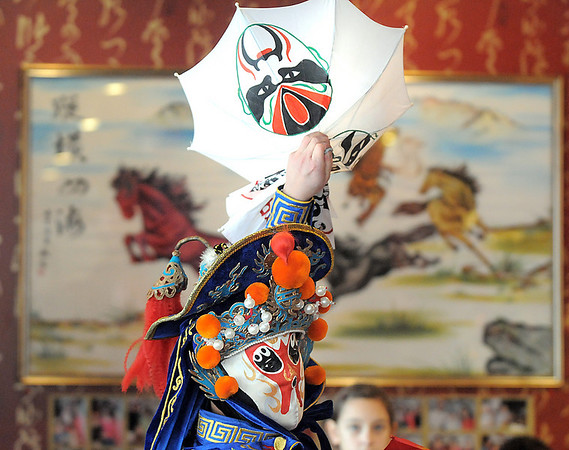 Magician Peng Li, a master of the Chinese art of face mask changing, performs the rare part of the Chinese Sichuan opera during the Chinese New Year celebration at United Chinese Restaurant on Sunday. February 3rd is the beginning of the Chinese New Year, the year of the rabbit.<br /> <br /> January 30, 2011<br /> staff photo/David R. Jennings