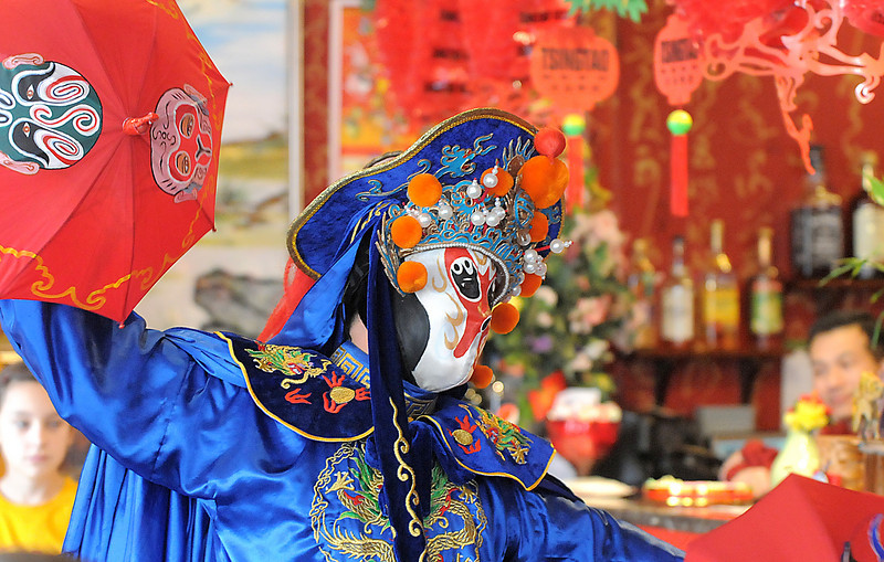 Magician Peng Li, a master of the Chinese art of face mask changing, moves to reveal another mask while performing the rare ancient Chinese dramatic art of Bian Lian a part of the Sichuan opera for the Chinese New Year celebration at United Chinese Restaurant on Sunday. February 3rd is the beginning of the Chinese New Year, the year of the rabbit. Mr. Li flew in from New York City to perfom in Broomfield.<br /> <br /> January 30, 2011<br /> staff photo/David R. Jennings