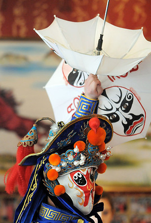 Magician Peng Li, a master of the Chinese art of face mask changing, moves to reveal another mask while performing the rare ancient Chinese dramatic art of Bian Lian a part of the Sichuan opera for the Chinese New Year celebration at the Broomfield United Chinese Restaurant on Sunday.<br /> January 30, 2011<br /> staff photo/David R. Jennings
