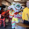 Richard Archer, right, drums as the Tai Kung Ha Holistic Fitness Center members perform the Lion Dance at the entrance to the Pacific Ocean Marketplace in Broomfield to celebrate the Chinese New Year, the year of the Tiger, on Sunday.<br /> <br /> February 14, 2010<br /> Staff photo/David R. Jennings