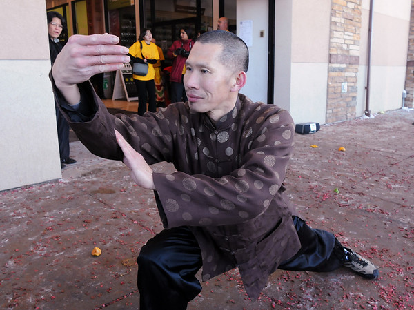 Daniel Lee Ha, founder of the Tai Kung Ha Holistic Fitness Center performs Tai Chi after the lion dance at the Pacific Ocean Marketplace in Broomfield on Sunday in celebration of the Chinese New Year, the year of the Tiger.<br /> <br /> February 14, 2010<br /> Staff photo/David R. Jennings