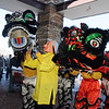Tai Kung Ha Holistic Fitness Center members lead by by the Happy Buddha, Alexandra Ralat, perform the Lion Dance to help bring in the Chinese New Year, the year of the Tiger, at Pacific Ocean Marketplace in Broomfield on Sunday.<br /> <br /> February 14, 2010<br /> Staff photo/David R. Jennings