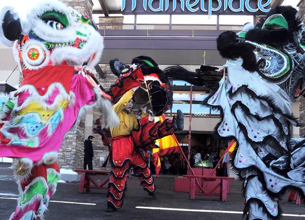 Tai Kung Ha Holistic Fitness Center members perform the Lion Dance in celebration of the Chinese New Year, the year of the Tiger, at Pacific Ocean Marketplace in Broomfield on Sunday.<br /> <br /> February 14, 2010<br /> Staff photo/David R. Jennings