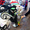 Trong Lam, owner of the Pacific Ocean Marketplace in Broomfield, places lettuce for the Lions for Chinese New Year, the year of the Tiger, on Sunday. Members of the Tai Kung Ha Holistic Fitness Center perform the Lion Dance.<br /> <br /> February 14, 2010<br /> Staff photo/David R. Jennings