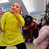 The Happy Buddha, Alexandra Ralat, guides the lions with Tai Kung Ha Holistic Fitness Center through the aisles of the Pacific Ocean Marketplace during the Lion Dance in celebration of the Chinese New Year, the year of the Tiger, on Sunday.<br /> <br /> February 14, 2010<br /> Staff photo/David R. Jennings