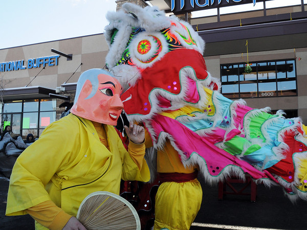 The Happy Buddha, Alexandra Ralat, leads the three Lions of Tai Kung Ha Holistic Fitness Centeras they perform the Lion Dance to for the Chinese New Year, the year of the Tiger, at Pacific Ocean Marketplace in Broomfield on Sunday.<br /> <br /> February 14, 2010<br /> Staff photo/David R. Jennings