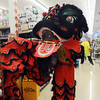 A red lion manned by members of the Tai Kung Ha Holistic Fitness Center dances through the Pacific Ocean Marketplace in Broomfield during the Lion Dance in celebration of the Chinese New Year, the year of the Tiger, on Sunday.<br /> <br /> February 14, 2010<br /> Staff photo/David R. Jennings
