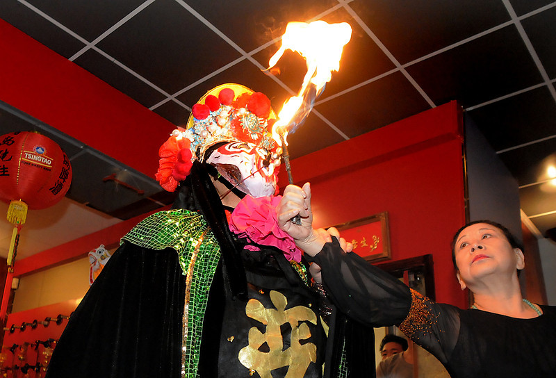 "Magician Naiyi Zhao, from New York, breaths fire while performing the Bian Lain or face changing for the Chinese New Year celebration at United Chinese Restaurant on Monday. <br /> For more photos please see  <a href=""http://www.broomfieldenterprise.com"">http://www.broomfieldenterprise.com</a><br /> January 23, 2012<br /> staff photo/ David R. Jennings"