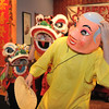 "Happy Buddha, Allen Tran, with the Tai Kung Ha Holistic Fitness Center, leads the baby lions, Amy Hatchett, 6, left, and Gabbi Kovalenko, 10, during the traditional lion dance for Chinese New Year at United Chinese Restaurant on Monday.<br /> For more photos please see  <a href=""http://www.broomfieldenterprise.com"">http://www.broomfieldenterprise.com</a><br /> January 23, 2012<br /> staff photo/ David R. Jennings"