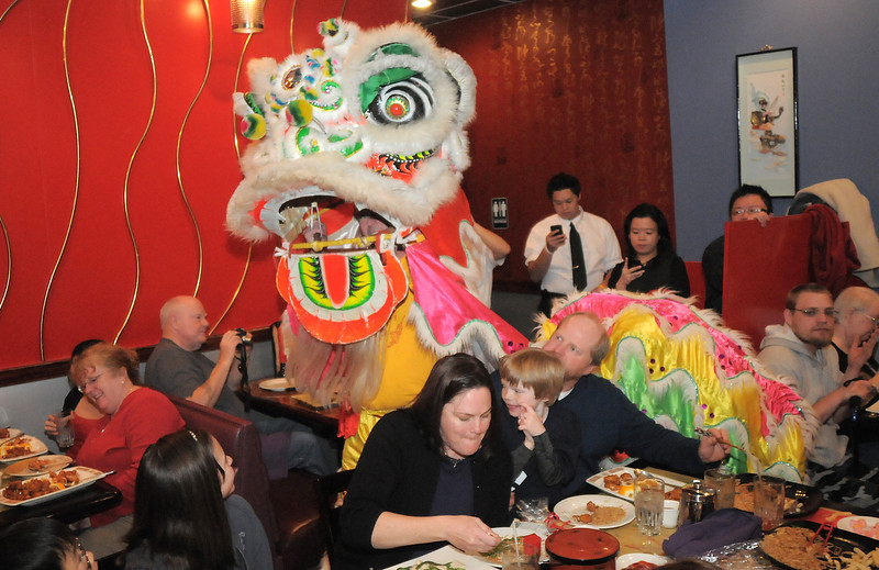 Doug Sexton, the yellow lion, makes his way through the restaurant during the traditional lion dance performance by the Tai Kung Ha Holistic Fitness Center, at the United Chinese Restaurant in celebration of Chinese New Year, the year of the dragon, on Monday.<br /> January 23, 2012<br /> staff photo/ David R. Jennings