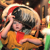 "Baby lion, Amy Hatchett, 6, peaks out from her costume during the traditional lion dance performance by the Tai Kung Ha Holistic Fitness Center, into the United Chinese Restaurant to celebrate Chinese New Year, the year of the dragon, on Monday.<br /> For more photos please see  <a href=""http://www.broomfieldenterprise.com"">http://www.broomfieldenterprise.com</a><br /> January 23, 2012<br /> staff photo/ David R. Jennings"
