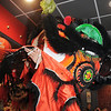 Thuan Tran, the red lion, reaches for the lettuce on the ceiling during the traditional lion dance performance by the Tai Kung Ha Holistic Fitness Center, into the United Chinese Restaurant to celebrate Chinese New Year, the year of the dragon, on Monday.<br /> January 23, 2012<br /> staff photo/ David R. Jennings