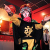 New York Chinese magician, Naiyi Zhao, moves a cane while performing the Bian Lain or face changing for the Chinese New Year celebration at United Chinese Restaurant on Monday. <br /> January 23, 2012<br /> staff photo/ David R. Jennings