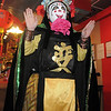 New York Chinese magician Naiyi Zhao performs the Bian Lain or face changing for the Chinese New Year celebration at United Chinese Restaurant on Monday. Zhao went through 14 face changes before revealing his face to the audience.<br /> January 23, 2012<br /> staff photo/ David R. Jennings