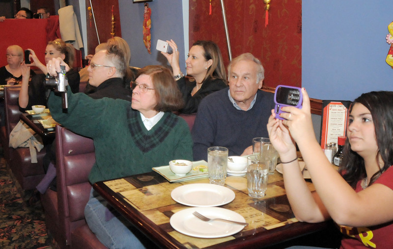 "Customers of United Chinese Restaurant  take pictures of the lion dance performance in  celebration of Chinese New Year, the year of the dragon, on Monday.<br /> For more photos please see  <a href=""http://www.broomfieldenterprise.com"">http://www.broomfieldenterprise.com</a><br /> January 23, 2012<br /> staff photo/ David R. Jennings"