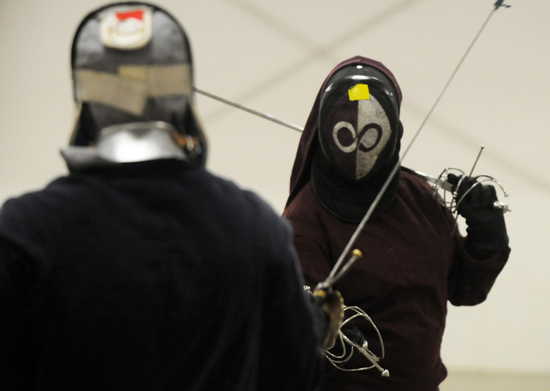 Caelaelin Tighe ( Kaitlin Porter of north Denver), right, practices her fencing techniques with Jethro Stille (Russell Weisfield of Arvada)at the Society for Creative Anachronism meeting of the Barony of Caer Galen for Boulder and Broomfield counties at the Boulder County Fairgrounds in Longmont on Tuesday.<br /> <br /> <br /> January 12, 2010<br /> Staff photo/David R. Jennings
