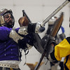 Hans (Josh Wolff of Denver) left, fights Kelsus ( Justin Ramser of Lakewood) during heavy weapons practice at the Society for Creative Anachronism meeting of the Barony of Caer Galen for Boulder and Broomfield counties at the Boulder County Fairgrounds in Longmont on Tuesday. The white belt Wolff is wearing denotes a rank of knight.<br /> <br /> <br /> January 12, 2010<br /> Staff photo/David R. Jennings