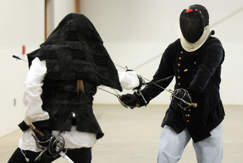 BE0117SCA01<br /> Jethro Stille (Russell Weisfield of Arvada), right, practices fencing with Domin d'Alsace ( Justin Cragin of Parker) at the Society for Creative Anachronism meeting of the Barony of Caer Galen for Boulder and Broomfield counties at the Boulder County Fairgrounds in Longmont on Tuesday.<br /> <br /> <br /> January 12, 2010<br /> Staff photo/David R. Jennings