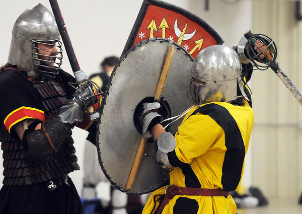 Constantine Alexander (Todd Dyjak, of Laffayette) left, battles Kelsus (Justin Ramser, of Lakewood) during heavy weapons practice at the Society for Creative Anachronism meeting of the Barony of Caer Galen for Boulder and Broomfield counties at the Boulder County Fairgrounds in Longmont on Tuesday.<br /> <br /> <br /> January 12, 2010<br /> Staff photo/David R. Jennings