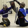 "Hans (Justin Wolff), left, and Argyle (Nick Solick of Denver) are on their knees while fighting denoting they've been ""injured"" by a sword blow at the Society for Creative Anachronism meeting of the Barony of Caer Galen for Boulder and Broomfield counties at the Boulder County Fairgrounds in Longmont on Tuesday. Fighters use the honor system for acknowledging injuries during a fight.<br /> <br /> <br /> January 12, 2010<br /> Staff photo/David R. Jennings"