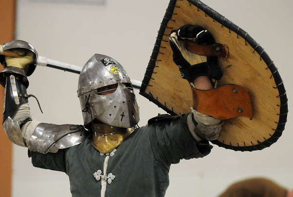 Mustafa Kamal (Jim Stanley, of Broomfield) prepares to engage his opponent during heavy weapons practice at the Society for Creative Anachronism meeting of the Barony of Caer Galen for Boulder and Broomfield counties at the Boulder County Fairgrounds in Longmont on Tuesday.<br /> <br /> <br /> January 12, 2010<br /> Staff photo/David R. Jennings