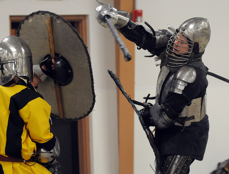 Anton Von Strassburg ( Gary Holland), right, engages Kelsus ( Justin Ramser) in combat at the Society for Creative Anachronism meeting of the Barony of Caer Galen for Boulder and Broomfield counties at the Boulder County Fairgrounds in Longmont on Tuesday.<br /> <br /> <br /> January 12, 2010<br /> Staff photo/David R. Jennings