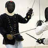 Jethro Stille (Russell Weisfield of Arvada), left, practices fencing with Domin d'Alsace ( Justin Cragin of Parker) at the Society for Creative Anachronism meeting of the Barony of Caer Galen for Boulder and Broomfield counties at the Boulder County Fairgrounds in Longmont on Tuesday.<br /> <br /> <br /> January 12, 2010<br /> Staff photo/David R. Jennings