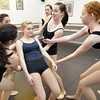 Emily Westbrook, 15, center, begins to fall aided by fellow dancers for a movement exercise during the choreography class at Dance Arts Studio on Saturday.<br /> January 26, 2013<br /> staff photo/ David R. Jennings