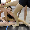 Aliyah Price, 15, looks through fellow dancer's legs for a body movement exercise during the choreography class at Dance Arts Studio on Saturday.<br /> January 26, 2013<br /> staff photo/ David R. Jennings