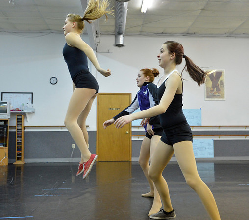 Emily Westbrook, 15, left, jumps from fellow dancers Sarah Fanning, 16, center, and Gabby Green, 17, while performing a dance choreographed by Hailey Mohler during the choreography class at Dance Arts Studio on Saturday.<br /> January 26, 2013<br /> staff photo/ David R. Jennings