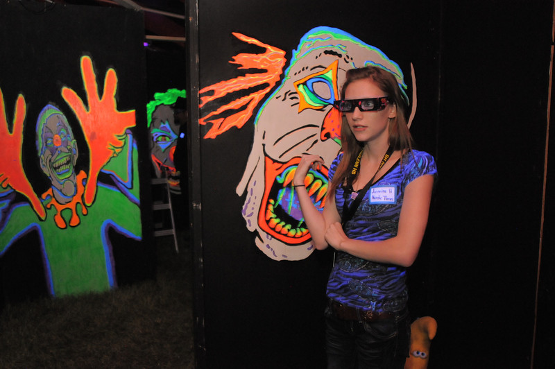 Northglenn High student Jasmine Heide, wearing 3D glasses,  pauses by the scarey clowns while on a brief tour of the Circus of Fear 3D Haunted Fun House at FatCats  in Westminster on Thursday.<br /> September 29, 2011<br /> staff photo/ David R. Jennings
