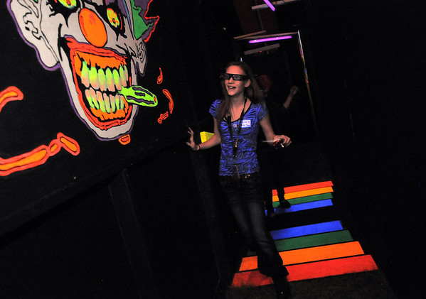"Northglenn High student Jasmine Heide, while wearing 3D glasses,  tries to find her way through the ""stairs"" and scarey clowns in the maze of the Circus of Fear 3D Haunted Fun House at FatCats  in Westminster on Thursday.<br /> <br /> September 29, 2011<br /> staff photo/ David R. Jennings"