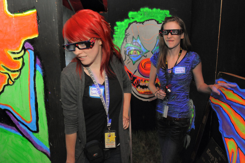 Northglenn High students Kelsey Nelson, left, and Jasmine Heide, wearing 3D glasses, make their way through part of the maze in the Circus of Fear 3D Haunted Fun House at FatCats  in Westminster on Thursday.<br /> <br /> September 29, 2011<br /> staff photo/ David R. Jennings